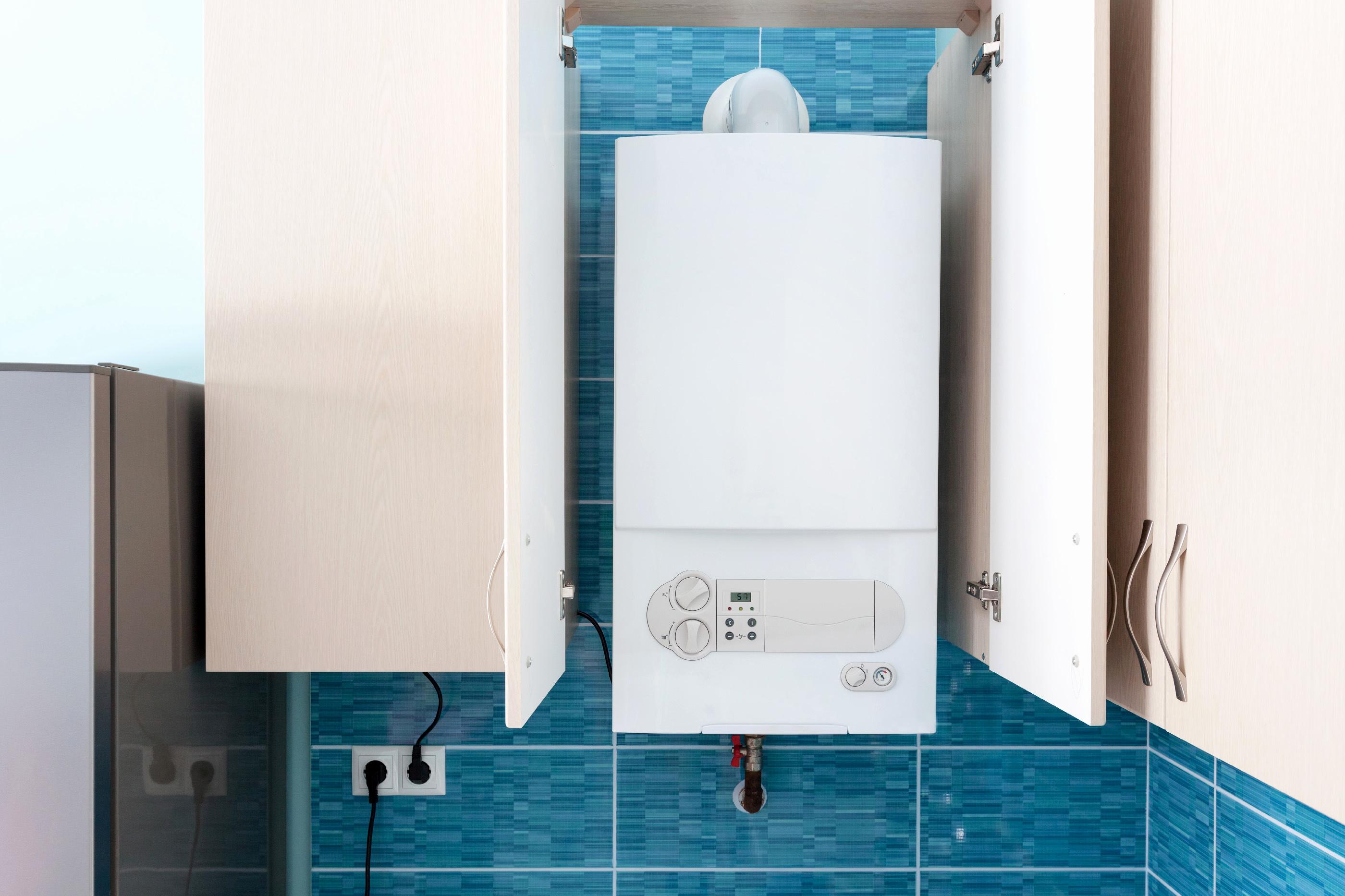 Как скрыть газовый котел в туалете